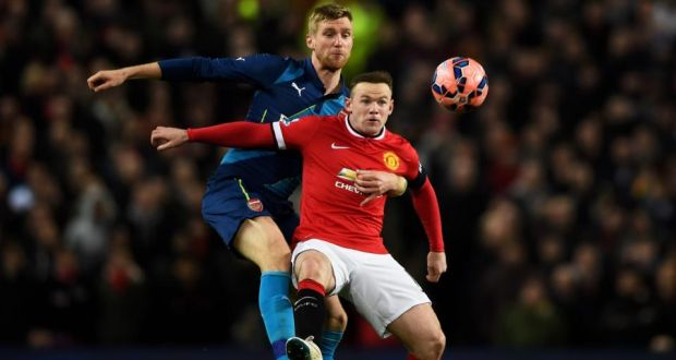 3b31dd217 Manchester United s Wayne Rooney is tackled by Arsenal s Per Mertesacker  during the FA Cup quarter-