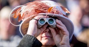 A racegoer watches the first race on the first day of the Cheltenham festival. Photograph: Matt Cardy/Getty Images