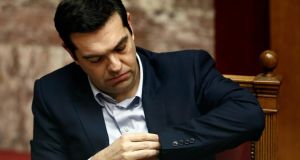 Greek prime minister Alexis Tsipras prepares to address lawmakers on Tuesday during a parliamentary session on the creation of a committee for claiming second World War reparations. Photograph:  Reuters/Alkis Konstantinidis