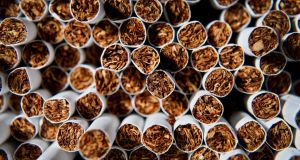 As England is set to introduce standardised cigarette packaging, Imperial Tobacco has warned the British government that it will sue to protect its intellectual property rights.  Photograph: Daniel Acker/Bloomberg