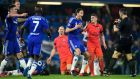 Chelsea players converge upon referee Bjorn Kuipers following a controversial tackle by Zlatan Ibrahimovic on Oscar that resulted in a red card for the PSG striker. Photo: Mike Hewitt/Getty