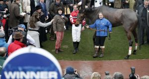 <b>SWEAT AND GLORY </b><br> Jockey Nico de Boinville stands with his horse Coneygree in the winner&#39;s enclosure after winning the  Gold Cup