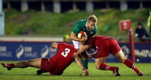 Ireland's Jeremy Loughman is tackled by the Wales duo of  Dillon Lewis and Luke Garrett during the Under-20 Six Nations match at Parc Eirias in  Colwyn Bay. Photograph: Morgan Treacy/Inpho