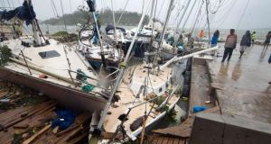 This handout photo taken  by UNICEF Pacific shows storm damage to boats caused by Cyclone Pam, in the Vanuatu capital of Port Vila. Photograph: UNICEF Pacific/AFP/Getty Images.