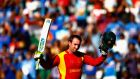 Brendan Taylor of Zimbabwe salutes the crowd as he leaves the field after making 138 in his final international match in the World Cup game against India   at Eden Park  in Auckland. Photograph:  Phil Walter/Getty Images