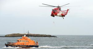The man was winched from the cliff base and airlifted to University Hospital Galway where he was treated for minor injuries and hypothermia. Photograph: Dara Mac Dónaill/The Irish Times.