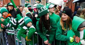 Spectators watch the St. Patrick's Day Parade move down Broadway in South Boston, Massachusetts March 15, 2015. Photograph: Dominick Reuter/Reuters