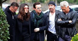 Bono with his wife Ali and U2 band members Larry Mullen , Adam Clayton and The Edge, at the funeral of radio DJ Tony Fenton, at Donnybrook, Dublin. Photograph: Eric Luke