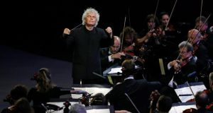 New breed: Simon Rattle works as readily with period-instrument players as with symphony orchestras. Photograph: Jonathan Brady/EPA