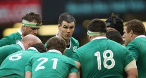 Sex appeal: Ireland outhalf Johnny Sexton leads a team talk in the huddle during last week's crunch game against Wales. Photograph: Billy Stickland/Inpho