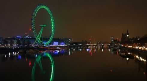 The London Eye on London's South Bank is lit green by Tourism Ireland to celebrate St Patrick's Day. Photo: Matt Alexander/PA Wire