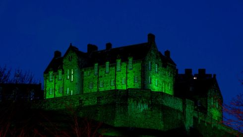Edinburgh Castle in Scotland illuminated green as it is among more than 100 international landmarks turning green to mark St Patrick's Day. Photograph: Gareth Easton/PA Wire
