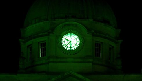 Government buildings in Dublin are illuminated in green for the St Patrick's Day festival tomorrow. Photo: Brian Lawless/PA Wire