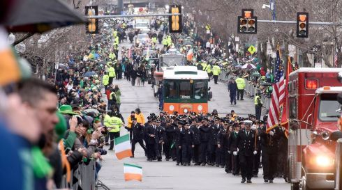Massachusetts Firefighters take part in the annual St Patrick's Day Parade in South Boston, Massachusetts.  Photograph: Tory Germann/EPA