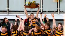 Lewis McNamara lifts the trophy as Royal Belfast Academical Institution celebrate their Danske Bank Ulster Schools Senior Cup Final victory at Kingspan Stadium, Belfast.  Photo: William Cherry/Inpho/Presseye