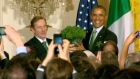 An Taoiseach Enda Kenny presents US President Barack Obama with a large pot of shamrocks to mark St. Patrick's Day. Video: Reuters