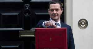 Britain's Chancellor of the Exchequer George Osborne  holds his red despatch box containing the budget outside 11 Downing street, Westminster. Photograph: PA/Will Oliver