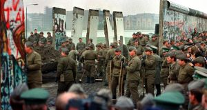 Influence: soldiers remove some of the first sections of the Berlin Wall at Potsdamer Platz, in November 1989; after Ireland organised two summits on German reunification, Gerry Collins was invited as the first foreign minister to visit East Germany after the  fall of the wall. Photograph: John Tlumacki/Boston Globe via Getty