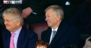Denis O'Brien and Alex Ferguson in Old Trafford last week: the businessman sold his stake in Australian firm APN four days later