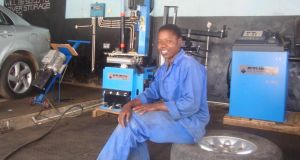 Giveth Mambo at work in her garage in Harare
