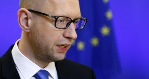 Ukraine's prime minister, Arseny Yatsenyuk, in Brussels yesterday after meeting European Council president Donald Tusk, who led calls for EU member states to commit to extending sanctions against Russia. Photograph: Francois Lenoir/Reuters
