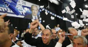 'The election had been called by Netanyahu not so much to steal a march on a rejuvenated opposition to his left but to strengthen his hand in dealings with cabinet allies to his right.' Above: supporters of Benjamin Natanyahu cheer as they hear the first  predictions of the Israeli election results. Photograph: Abir Sultan/EPA