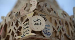 People left messages with markers all over the memorial structure. Photograph: Niall Carson/PA Wire