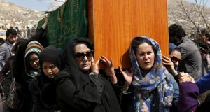 Farkhunda's coffin is borne by women before her burial. Photograph: Mohammad Ismail/Reuters