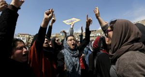Pressing for women's rights: Afghan  activists chant slogans during the funeral ceremony of Farkhunda. Photograph: Mohammad Ismail/Reuters