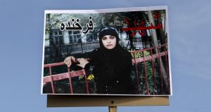 A poster bearing a picture of Farkhunda, an Afghan woman who was beaten to death and set on fire on Thursday, during her funeral ceremony in Kabul on March 22, 2015. Photograph: Mohammad Ismail/Reuters
