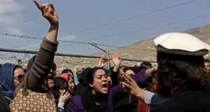 Afghan women's rights activists chant slogans during the funeral ceremony of Farkhunda, an Afghan woman who was beaten to death and set alight  on Thursday, in Kabul, March 22, 2015. Photograph: Mohammad Ismail/Reuters