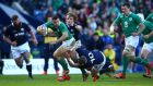 Robbie Henshaw of Ireland is tackled by Finn Russell of Scotland during the RBS Six Nations match at Murrayfield on Saturday. Photograph: Richard Heathcote/Getty Images