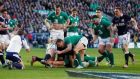 Flanker Seán O'Brien's outstretched arm proves just about long enough to score Ireland's crucial fourth try against Scotland. Photograph: Lee smith/Reuters.