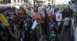 Climate change demonstrators in London recently: policymakers in Europe face a very difficult balancing act in tackling global warming. Photograph:  NIKLAS HALLE'N/AFP/Getty Images