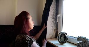 Carole Quinn showing mould in her flat in Inchicore, Dublin: she hopes the collective complaint will 'get us some answers and force the council to come up with a plan'. Photograph: Eric Luke / The Irish Times