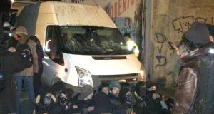 Protesters sitting in front of a van during the stand-off on Grangegorman Road Lower. Photograph: Dan Griffin