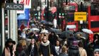 Pedestrians in  Oxford Street  on Tuesday. The prospect of the return of deflation after over 50 years had economists and journalists thumbing through the history books. Photograph: Andy Rain/EPA