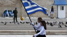 High school students march holding a Greek national flag during a school parade marking Greek Independence Day in Athens on Tuesday. The Greek government has positively assessed the meeting between Prime Minister Alexis Tsipras and German Chancellor Angela Merkel that took place March 23rd. (Photograph: SIMELA PANTZARTZI/EPA)