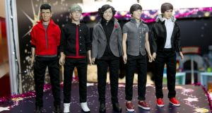 Plastic pop: One Direction figures. Photograph: John Phillips/UK Press via Getty