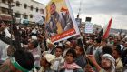 Yemeni supporters of the Shia Houthi militia hold a portrait the movement's leader, Abdul-Malik al-Huthi, yesterday.