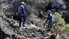 French gendarmes and investigators work amid the debris of the Germanwings Airbus A320