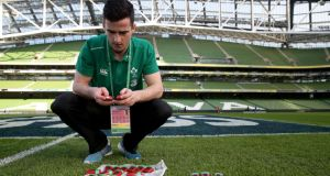 The IRFU's Dan Downey sets up the GPS units on the Aviva Stadium's pitch ahead of Ireland's Six Nations game against France in February. Photograph: Dan Sheridan/Inpho.