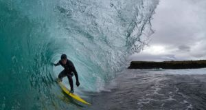 Cornish surfer Matt Smith surfing last winter.  Photograph: Al Mackinnon