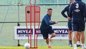 Robbie Keane being put through his paces ahead of the Poland game. LA-based striker should be more involved than last outing in Glasgow. Photograph: Donnall Farmer/Inpho