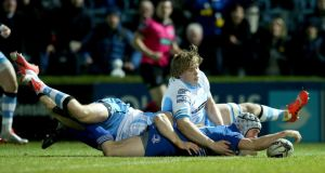 Isaac Boss stretches to score his second try to secure a bonus point for Leinster in their Guinness Pro 12 clash against Glasgow Warriors at the RDS. Photograph:   James Crombie/Inpho