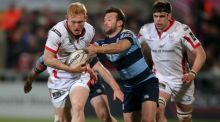 Ulster's Roy Scholes gets away from Cardiff's Gareth Davies during the Guinness Pro 12 game at ravenhill. Photograph: Darren Kidd/Inpho/Presseye
