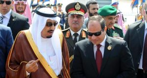 Egyptian President Abdel Fattah al-Sisi (right) receiving Saudi King Salman bin Abdulaziz Al Saud (left), in Sharm el-Sheikh, Egypt. Arab leaders started the annual summit conference in the Egyptian Red Sea resort town of Sharm al-Sheikh, with several of the countries in the grip of chaos. Arab leaders are expected to discuss a draft resolution to set up a pan Arab military force to intervene in regional crises. Photograph: Egyptian presidency/EPA