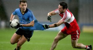 Cormac Costello of Dublin with Oisin Duffy of Derry. Photo: Donall Farmer/Inpho