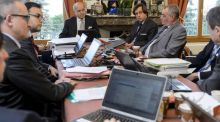 French foreign minister Laurent Fabius (centre) and director-general for political and security affairs at the French foreign ministry Nicolas de Riviere (right) attend a working session with their team  during Iran nuclear talks in Lausanne.  Photograph: Fabrice Coffrini/AFP/Getty Images