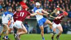 Waterford's Shane Fives is under pressure from Galway's Joe Canning and Niall Healy. Photograph: Ken Sutton/Inpho